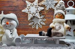 Christmas decoration - Christmas scene - boy on a sled and snowman Stock Photo