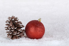 Christmas decoration with christmas tree ball, fir cone and snow Royalty Free Stock Photography