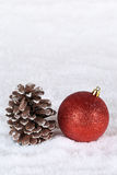 Christmas decoration with christmas tree ball, snow and copyspac Stock Photos