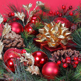 Christmas Decoration. Christmas tree branch with red bolls Stock Photos