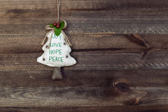 Christmas decoration. Christmas tree hanging over wooden backgro Royalty Free Stock Photography