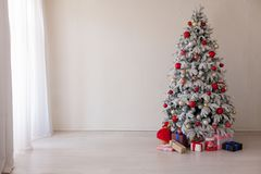 Christmas decoration Christmas tree with presents in white. 1 Stock Image