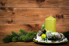 Christmas decoration - christmas wreath and coniferous branch on the wooden background. Christmas decoration -  wreath and coniferous branch on the wooden Royalty Free Stock Image