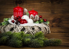 Christmas decoration - christmas wreath and coniferous branch on the wooden background. Christmas decoration -  wreath and coniferous branch on the wooden Royalty Free Stock Photo