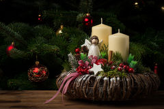 Christmas decoration - christmas wreath and coniferous branch on the wooden background. Christmas decoration - christmas wreath and coniferous branch on the Stock Photos