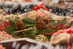 Christmas decoration with: Christmas wreath, pine branches, pine cones, yellow glitter Christmas stars Stock Photos