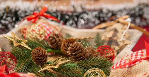 Christmas decoration with: Christmas wreath, pine branches, pine cones, yellow glitter Christmas stars Royalty Free Stock Photos