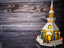 Christmas decoration church. In front of a wooden background Stock Photo