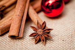 Christmas decoration cinnamon anise baubles in red Stock Images