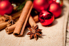 Christmas decoration cinnamon anise baubles in red Royalty Free Stock Images
