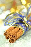 Christmas decoration, cinnamon sticks and bokeh Stock Images