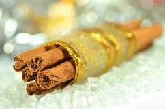 Christmas decoration, cinnamon sticks and bokeh Royalty Free Stock Images
