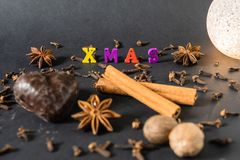 Christmas decoration with cinnamon sticks gingerbread and spices stock photography