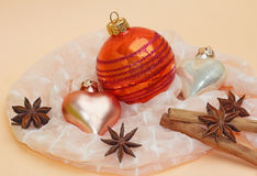 Christmas decoration with cinnamon sticks, star anise and christmas balls. Pastel colors stock photo