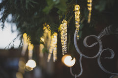 Christmas decoration with circle of lights background. Christmas decoration with brushwood and blurred lights stock images