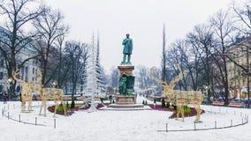 Christmas decoration city helsinki.Statuya Ludwig Runeberg.  Royalty Free Stock Photography
