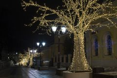Christmas decoration of the city. Illuminated by colored lights Royalty Free Stock Image