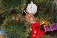 Christmas decoration - clock and angel. Christmas decoration - white clock and red angel on christmas tree Stock Photo