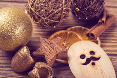 Christmas decoration, close-up, anise, cinnamon, red Christmas ball Stock Photos