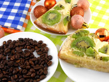 Christmas decoration with coffee beans and sweet kiwi cake Stock Images