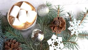 Christmas decoration with coffee cup, toys and pine tree on white wooden table.  stock video