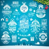 Christmas decoration collection of calligraphic and typographic design with Holiday labels, symbols and icons design. Elements on blue winter landscape Royalty Free Stock Photography