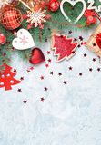 Christmas decoration collection: hearts, branches and bauble decor on stone background. Xmas backdrop for your greeting royalty free stock photography