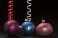 Christmas decoration with colorful balls and ribbons on black background Royalty Free Stock Images