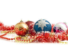 Christmas decoration - colorful tinsel and balls Stock Image