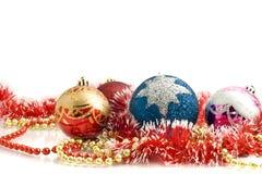 Christmas decoration - colorful tinsel and balls Stock Image