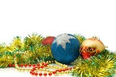 Christmas Decoration - colorful tinsel and balls Stock Photos