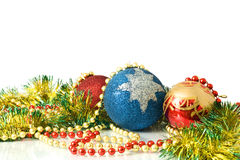 Christmas. Decoration - colorful tinsel and balls Royalty Free Stock Photography