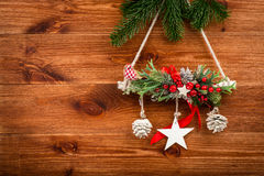 Christmas decoration - composition made from coniferous branches on the wooden background. Stock Photos