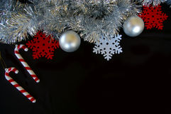 Christmas decoration composition tinsel bauble candy cane and snowflake Royalty Free Stock Photography