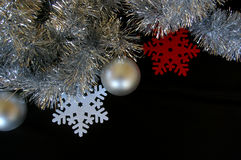 Christmas decoration composition tinsel baubles and snowflakes Stock Photo