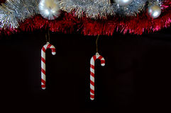 Christmas decoration composition tinsel candy canes and baubles Stock Image