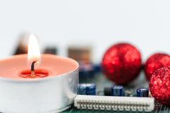 Christmas decoration on computer circuit board. Royalty Free Stock Images