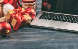 Christmas decoration and a computer laptop on an office desk. Copy space stock photo