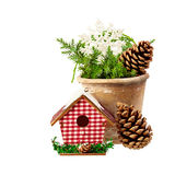Christmas Decoration (cone,birdhouse, pot, a branch of spruce) i Royalty Free Stock Image