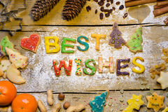 Christmas decoration and cookie letters on wooden table, best wi Royalty Free Stock Photography