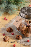 Christmas decoration with cookies, cranberry and fir tree branch Royalty Free Stock Photo