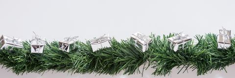 Christmas garland with silver gift boxes Stock Photo