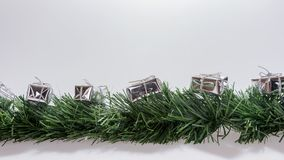 Christmas garland with silver gift boxes Royalty Free Stock Image