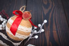 Christmas decoration. Copy space. Christmas tree toy on a wooden background. royalty free stock photo