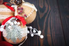 Christmas decoration. Copy space. Christmas tree toys on a wooden background. royalty free stock photography