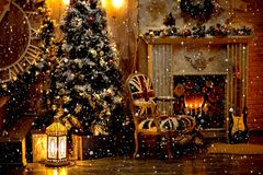 Christmas decoration in cozy house loft, fireplace Christmas tree guitar chair decoration toy boxes rug, candles royalty free stock images
