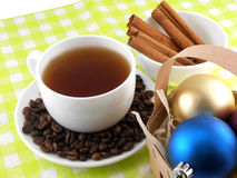 Christmas decoration with cup of coffee, coffee beans and cinnamon Stock Image