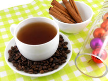 Christmas decoration with cup of coffee, coffee beans and cinnamon Stock Photos
