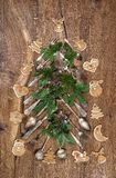 Christmas decoration cutlery cookies pine tree brunches. Christmas decoration cutlery, cookies and pine tree brunches on wooden background stock photo