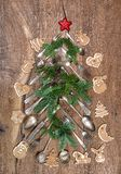 Christmas decoration cutlery cookies wooden background. Christmas decoration cutlery, cookies and pine tree brunches on wooden background stock image